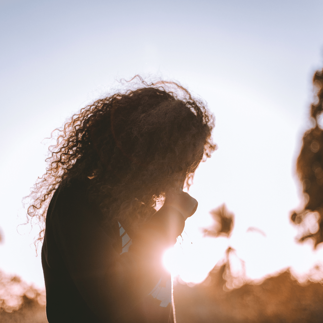 Woman looking down in sunshine